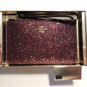Coach heart glitter small wristlet .